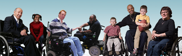 An image of National Spinal Cord Injury members. The members are all wheelchair users and are lined up in horizontal row. Represented are male and female members ranging from young children to seniors.