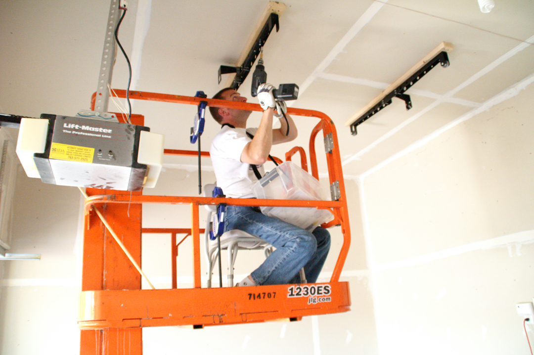 Stanchina in a vertical lift installing ceiling storage space.