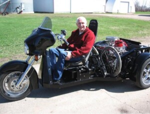 Wheelchair user sitting in a Liberator Trike